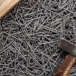 Old hammer nails and wooden board — Stock Photo