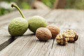 Fresh walnuts on the wooden table — Stockfoto