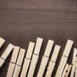 Wooden clothes pegs on table — Stock Photo #41944399