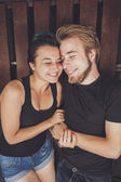 Happy loving couple in the boat — Stock Photo