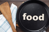 Frying pan with word food — 图库照片