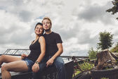Happy loving couple on the river bank — Stock Photo