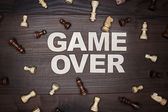 Game over concept on wooden background — Stock fotografie