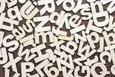 Uppercase and lowercase wooden letters background — Stock Photo