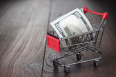 A hundred dollars in the shopping trolley — Foto de Stock