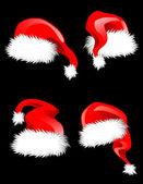 Hats of Santa Claus — Stock Vector
