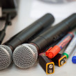 Microphones, pens and electric batteries — Stock Photo #13405012