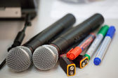 Microphones, pens and electric batteries — Stock Photo