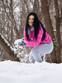 Girl playing  snowballs — Stock Photo