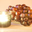Candle and grapes — Stock Photo