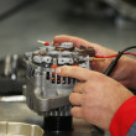 Mechanic restores a generator — Stock Photo #31401873