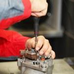 Mechanic restores a generator — Stock Photo #31401877