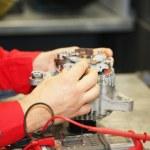 Mechanic restores a generator — Stock Photo #31401879