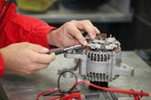 Mechanic restores a generator — Stock Photo