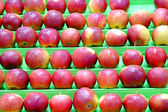Background with the image of apples on a counter — Stock Photo