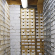 Stock Photo: Rows of shelves in warehouse
