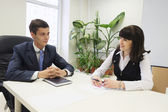Boss and secretary in  office — Stock Photo