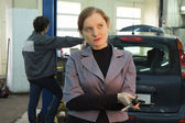 Woman at car service — Stock Photo