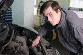 Mehanic works in a service center — Stock Photo
