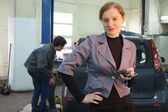 Woman at car service — Stock Photo
