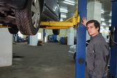Mechanic  in car service center — Stock Photo