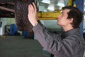 Mechanic  in car service center — Stock Photo