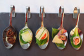 Appetizers  on party spoons — Stock Photo