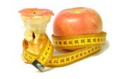 Apples and measure tape — Stock Photo