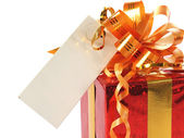 Red gift with blank tag — Stock Photo