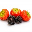 Strawberries and blackberries on a white background — Stock Photo