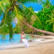 Beautiful girl on a tropical beach — Stock Photo