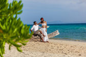 Couple on a tropical beach — Stock fotografie