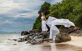 Girl on a tropical beach — Stock Photo