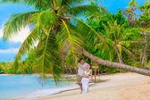 Couple on a tropical beach — Stock Photo