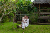 Romantic couple in a bungalow — Stock Photo
