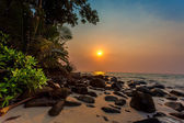 Sunset on a tropical beach — Foto Stock