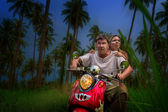 Romantic couple on a motorbike — Stock Photo