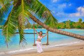 Beautiful girl on a tropical beach — Stock Photo
