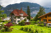 Swiss houses with a garden — Stock Photo