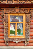 Window decorated with carving — Stock Photo