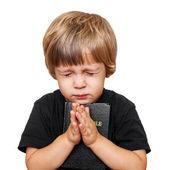 Mały chłopiec modląc się — Zdjęcie stockowe