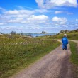 Boy walking country road — Stock Photo