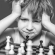 Boy playing chess — Stock Photo #23572805