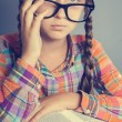 Stock Photo: Serious little girl in glasses with a book