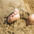 Child's feet in the sand — Stock Photo