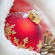 Christmas ball with red bow and ribbon — Stock Photo