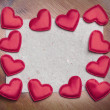 Red hearts on vintage paper background — Zdjęcie stockowe