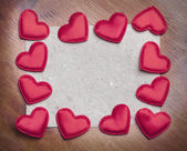 Red hearts on vintage paper background — Stock Photo