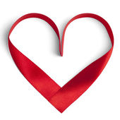 Red ribbon in a heart shape isolated on white — Stock Photo