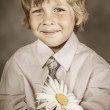 Boy wearing classic suit with flowers — Stock Photo